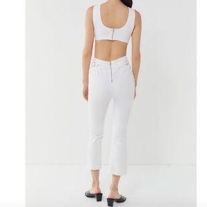 White jean cut out jumpsuit